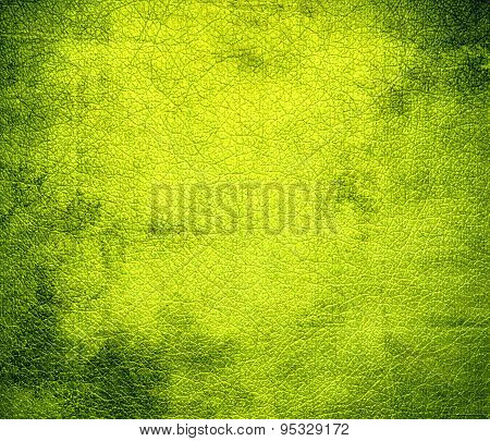 Grunge background of chartreuse (traditional) leather texture