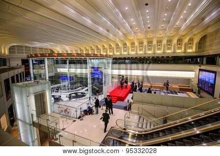 TOKYO, JAPAN - DECEMBER 28, 2012: News reporters set up inside the Tokyo Stock Exchange. It is the third largest exchange in the world.