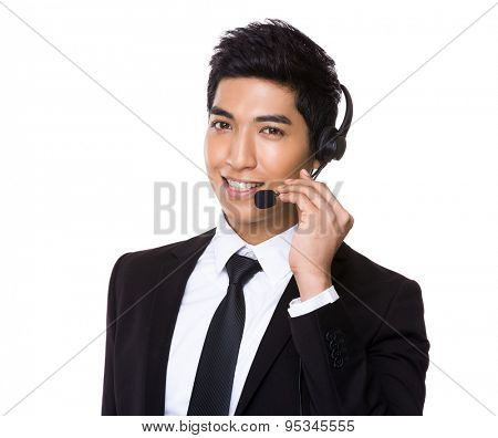 Chinese mixed Indian businessman with headset for hotline job aspect