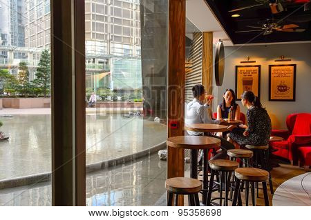 HONG KONG - JUNE 03, 2015: Pacific Coffee cafe interior. Pacific Coffee Company is a Pacific Northwest U.S.- style coffee shop group originating from Hong Kong