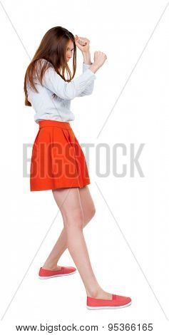 skinny woman funny fights waving his arms and legs. Rear view people collection.  backside view of person.  Isolated over white background. girl in red short skirt fights and waving his arms.