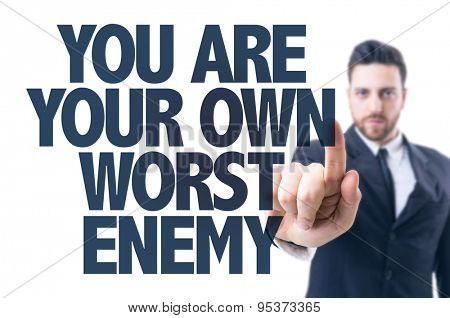 Business man pointing the text: You Are Your Own Worst Enemy