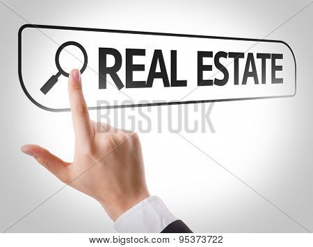 Real Estate written in search bar on virtual screen