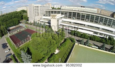 RUSSIA, MOSCOW - JUN 29, 2014: Edifice of sports complex of MGTU named by Bauman at summer sunny day in Moscow. Aerial view. Photo with noise from action camera