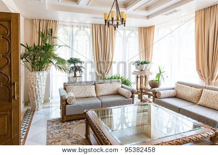 Novi Petrivtsi, Ukraine - May 27, 2015 Mezhigirya residence of ex-president of Ukraine Yanukovich. Spacious living room with modern furniture