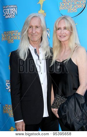 BURBANK - JUNE 25: Mick Garris and guest arrive at the 41st Annual Saturn Awards on Thursday, June 25, 2015 at the Castaway Restaurant in Burbank, CA.