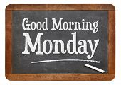 Good Morning Monday sign on a vintage slate blackboard with white chalk poster