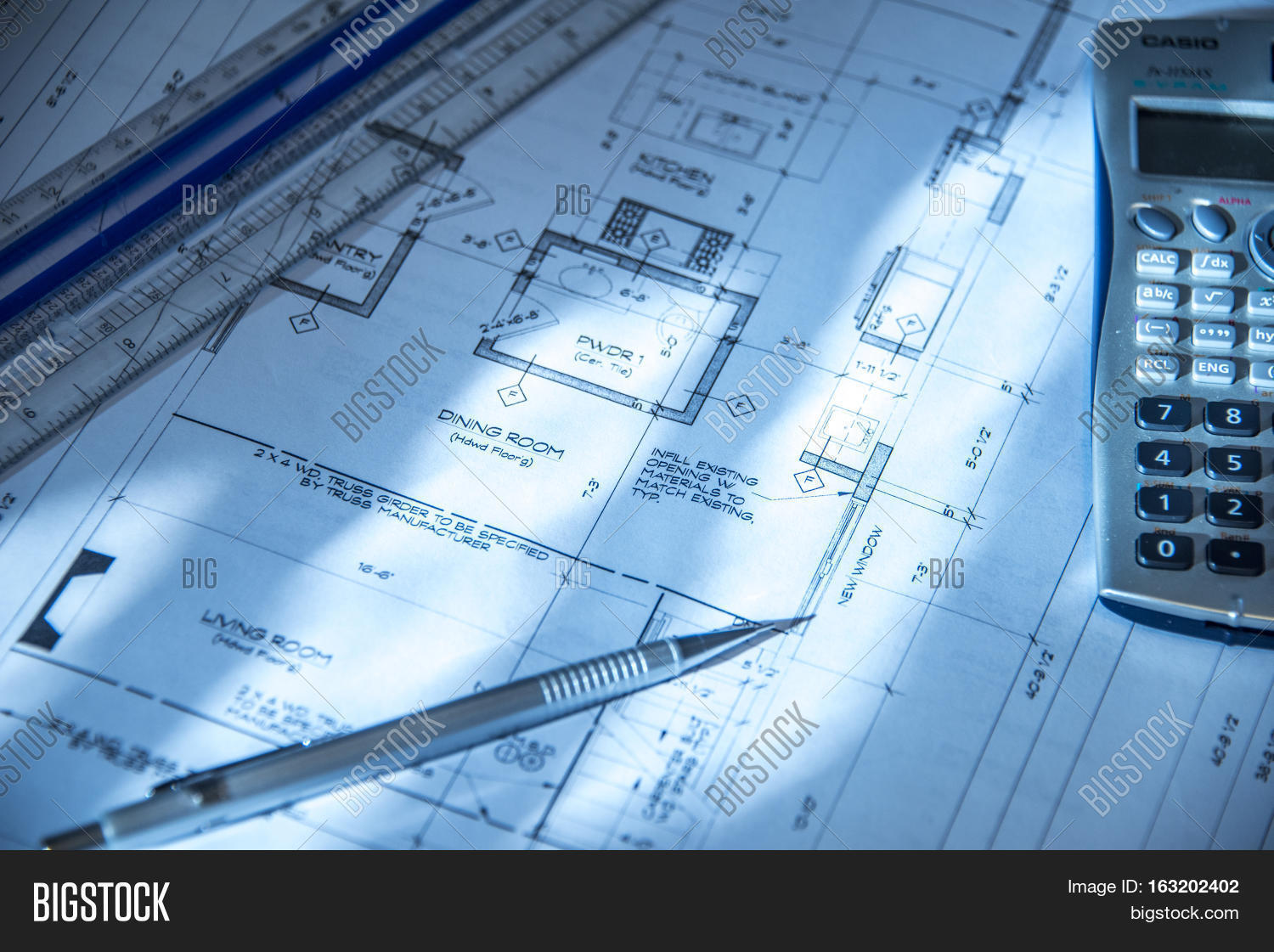 House construction image photo free trial bigstock house construction architect working on new house construction blueprint house construction plans calculator malvernweather Choice Image