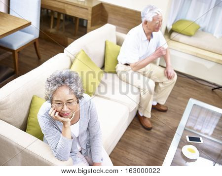 senior asian couple having relationship problem angry with each other high angle view.