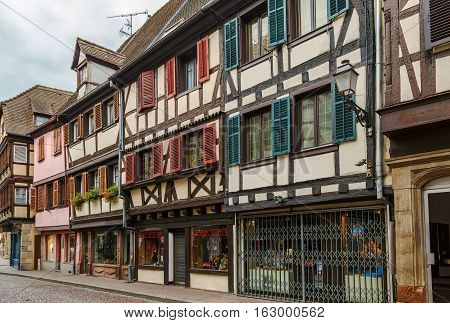 Street with historical half-timbered houses in Obernai Alsace France