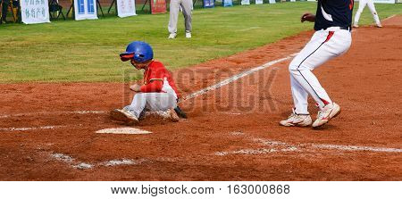 ZHONGSHAN GUANGDONGChina - October 28:player running to the base to get one point in a baseball match on October 28 2016.