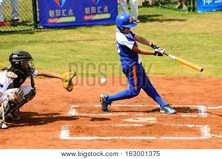 ZHONGSHAN GUANGDONGChina - October 27:unknown batter just missed the ball in a baseball game on October 27 2016.