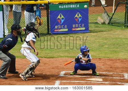 ZHONGSHAN GUANGDONGChina - October 27:unknown catcher about to catch a foul ball in a baseball game on October 27 2016.