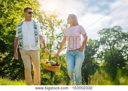 Mature couple looking for a place to picnicking.