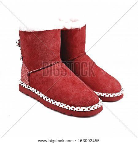 female red winter shoes over white background