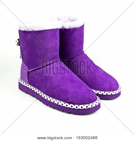 female purple winter shoes over white background