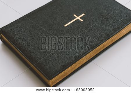Catholic Book With A Gold Cross, A Catholic Book With Gold Pages And Symbols. Catholic Faith In Jesu