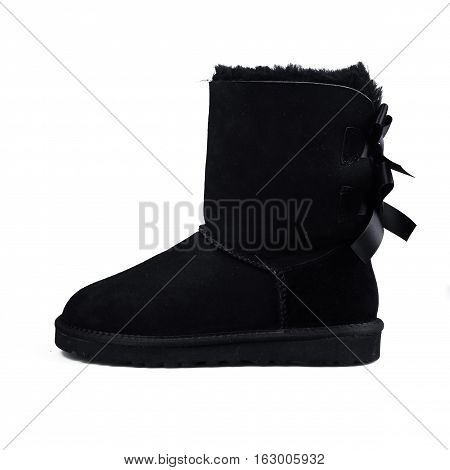 stylish black winter shoes over white background