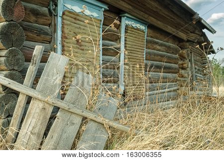 Wooden abandoned old house with the driven-in windows in Preobrazhenskoe. Tyumen region. Russia