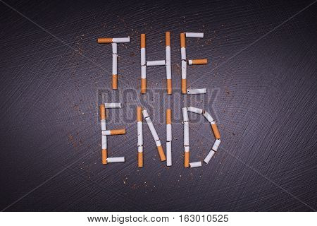 poster against smoking on dark stone background