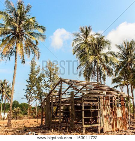 destroyed house damaged wooden ruin at beach
