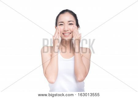 Portrait of attractive smiling Asian woman with beautiful skin isolated on white background