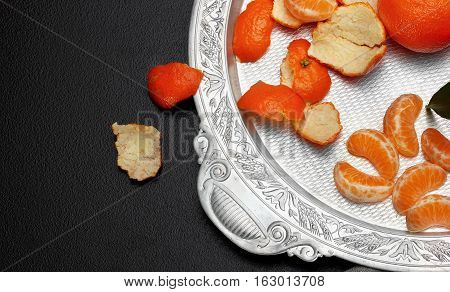 Fresh Tangerine Clementine With Leaves In Silver Tray On Dark Stone Background, Top View.copy Space