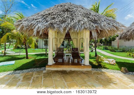 beautiful amazing view of cozy inviting gazebo in tropical garden on sunny gorgeous day