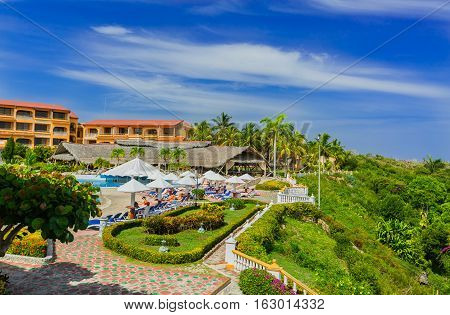 Holguin province, Sol Ri­o de Luna y Mares hotel, Cuba, Sep. 1, 2016, nice amazing fragment of view of Sol Rio de Luna y Mares hotel and grounds with people relaxing in background