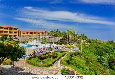 Holguin province, Sol Rio de Luna y Mares hotel, Cuba, Sep. 1, 2016, nice amazing fragment of view of Sol Rio de Luna y Mares hotel and grounds with people relaxing in background