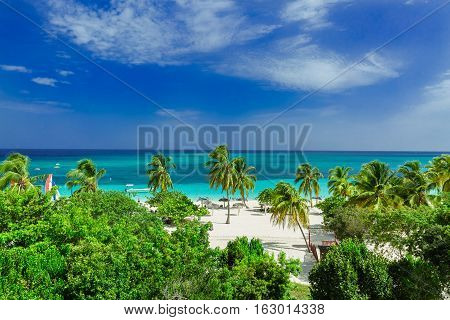 stunning gorgeous beautiful, amazing view of Holguin province tropical inviting beach and tranquil azure turquoise ocean on blue sky background