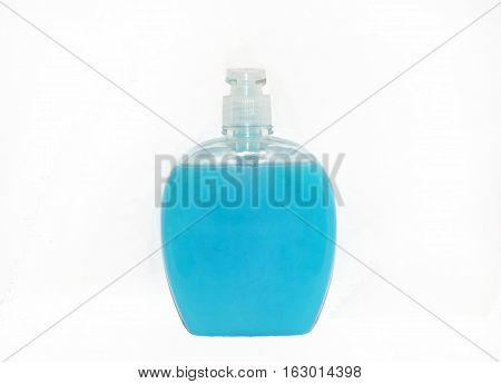 Transparent plastic bottle with blue liquid hand soap no label and white dispenser lid isolated on white background.