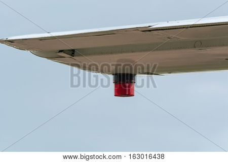 Wing of an airplane with position lighting.