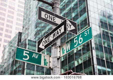 NEW YORK USA - May 01 2016: Street signs for Fifth avenue and W 56 st crossroad in New York City Manhattan USA