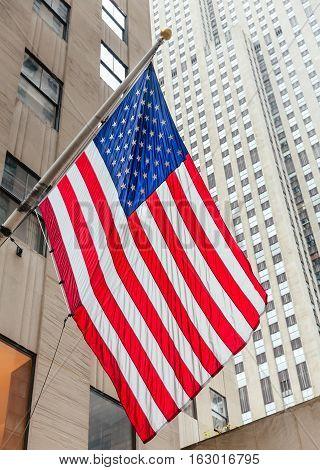 American flag on the Rockefeller Center background in New York City Midtown Manhattan