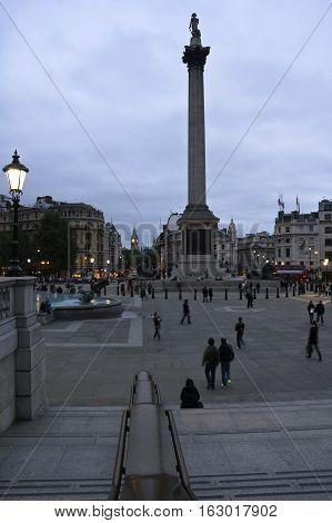 nelson's column in trafalgar square at dusk