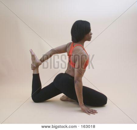 Woman Performing A Yoga Stretch
