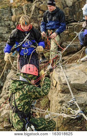Beklenischevo, Russia - April 29, 2006: Rock climbing of tourists on the rock