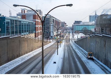 Montreal CA - 17 December 2016: A snowplow in motion during snow storm.
