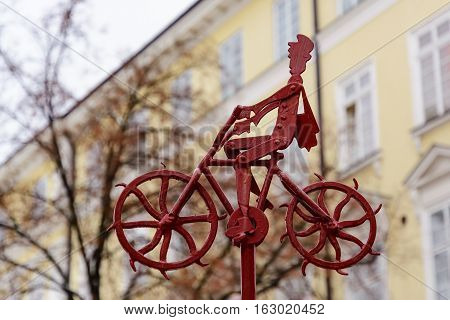 Forged metal figure bicyclist. City, street sculpture.