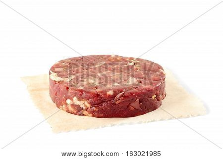 Raw beef burger patty isolated on white background