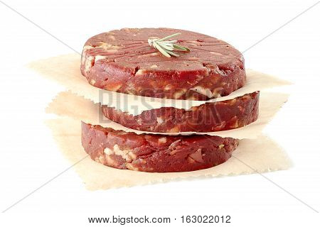 Stack of raw beef burger patties isolated on white background