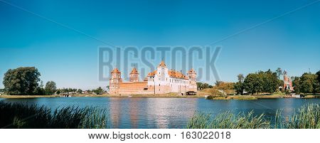 Mir, Belarus. Panoramic View Of Mir Castle Complex From Side Of Lake. Architectural Ensemble Of Feudalism, Ancient Cultural Monument, Famous Landmark In Summer Sunny Day Under Blue Sky, Copyspace. poster