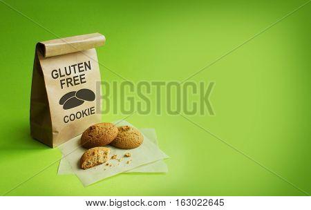Gluten-free cookies in the kraft bag. Green background. NO Gluten