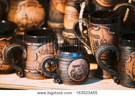 Tallinn, Estonia - December 2, 2016: Souvenir Beer Cup On Store Shelves. Various Traditional Earthenware Pottery Tableware Cups At Folk Market. Souvenir From Tallinn Estonia.