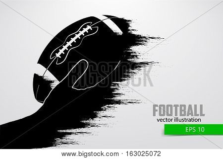 Hand holds the rugby ball, silhouette. Rugby. American football. Vector illustration