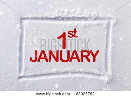 hand drawn square shape in the fresh snow with words 1st January