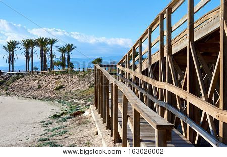 Wooden boardwalk leading to the Retamar beach. Almeria province Spain