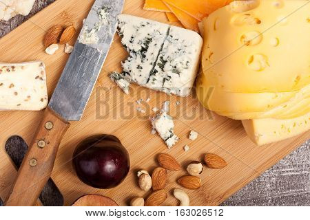 Close Up Of Cheese And Nuts On Wooden Background