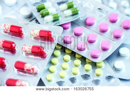 Overall view of pharmaceutical tablets and capsules in packages in assortment